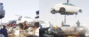 scrapyard-workers-shifting-cars-with-a-crane_kuwait