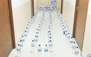liquor-bottles-seized-from-asians-in-mangaf_kuwait