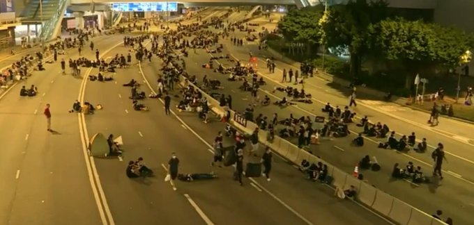 Hong Kong protests: Activists praised for clearing away rubbish and parting crowds for ambulances
